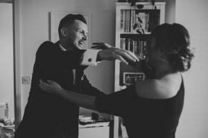 Best man greets bridesmaid