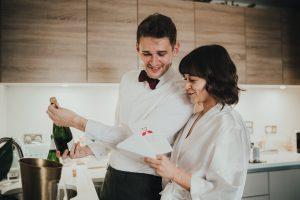 Bride and groom read wedding card