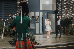 Bagpiper and bride and groom