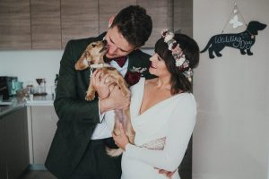 Bride and groom and miniature dachsund