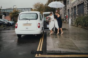 Bride getting in taxi