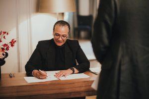 Registrar writing wedding documents