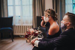 Wedding guest wipes away tears