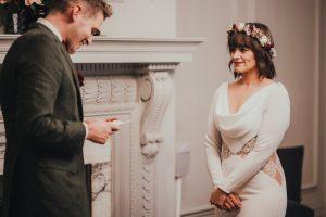 Bride feeling emotional as groom reads vows