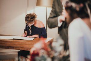 Bridesmaid signing register
