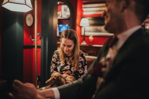 wedding guest with miniature dachsund on her lap