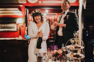 Bride opens champagne