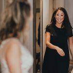 wedding guest sees bride in her dress