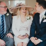 groom laughing with bride's parents
