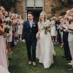 the bride and groom having bubble confetti