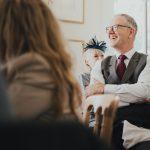 wedding guest smiling during speech