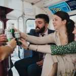 bridal party having gin and tonic on bus to wedding