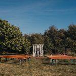 outdoor wedding ceremony the secret barn sussex