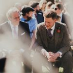 groom laughing with his dad before the ceremony