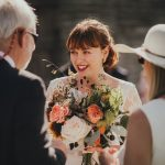 bride smiling when talking to wedding guests