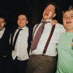 groom dancing with wedding guests