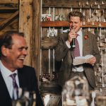 groom doing his speech as his dad laughs
