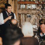 best man making groom embarrassed during speech