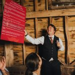 best man shows funny sign