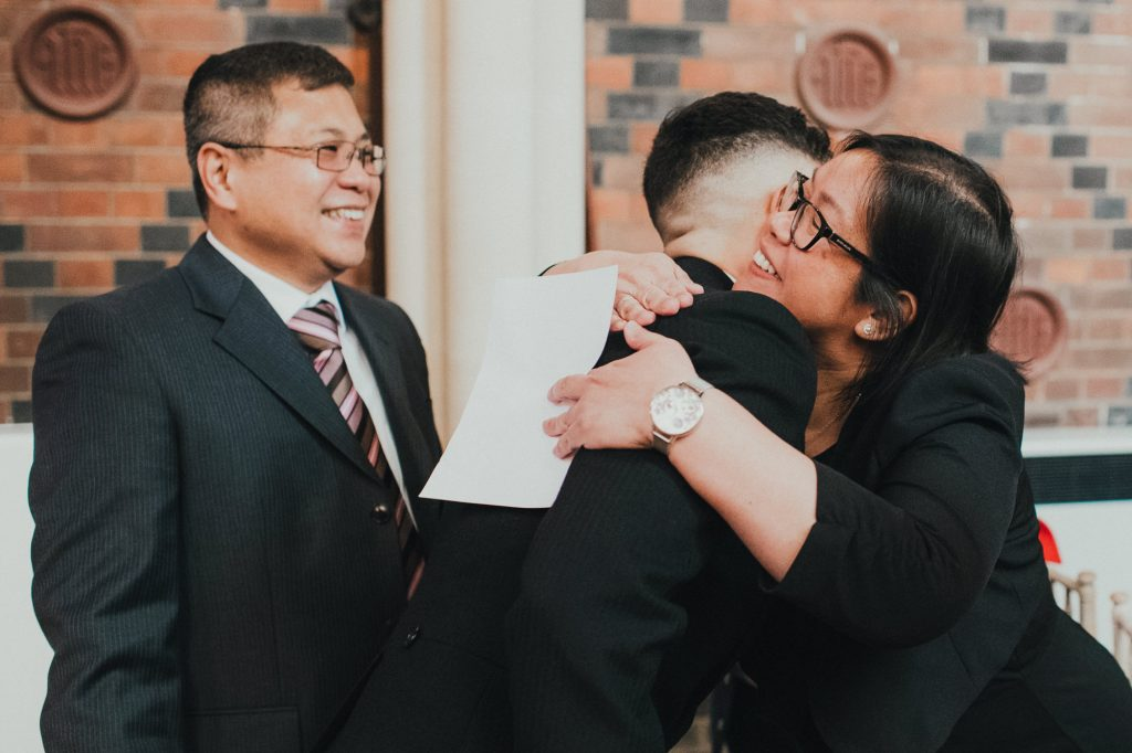 guests greet groom at wedding ceremony