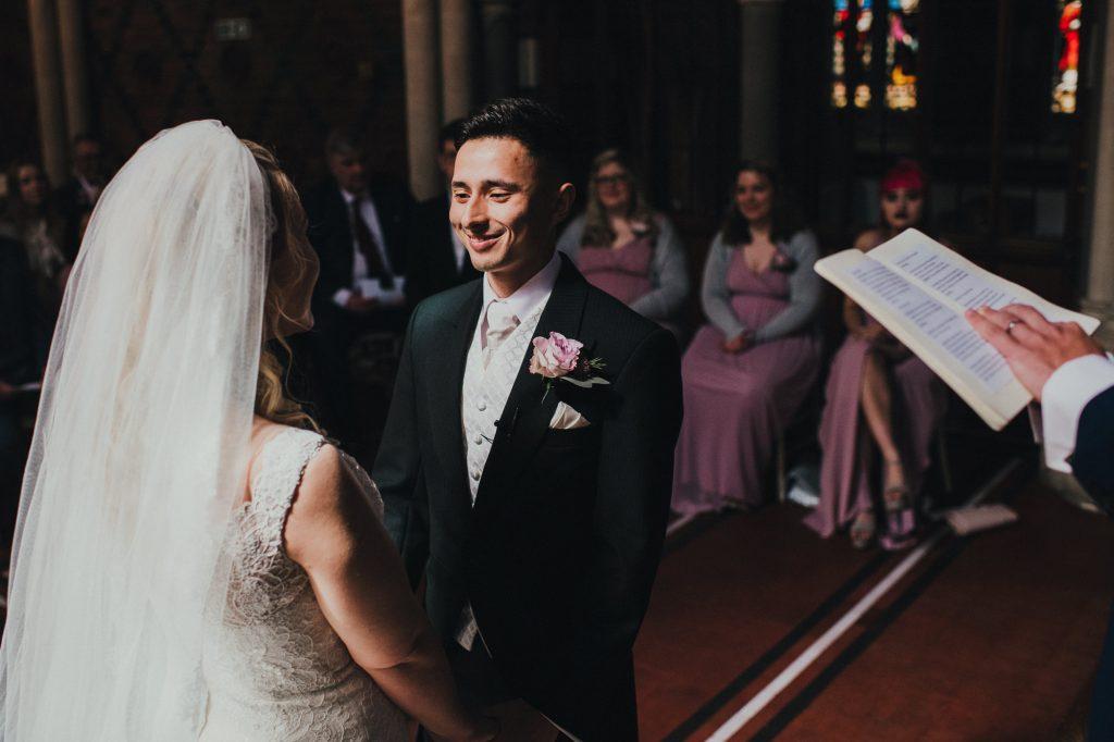 groom smiling during wedding