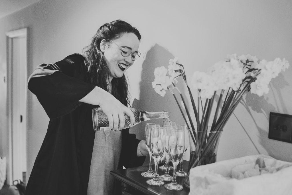 bridesmaid pouring prosecco