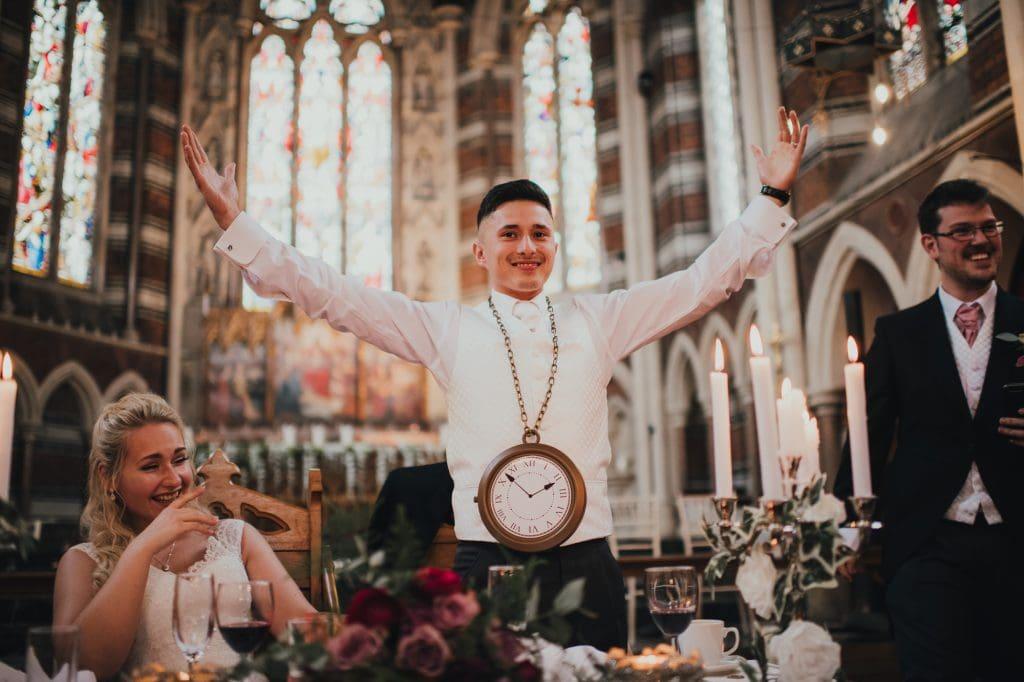 groom showing off novelty clock