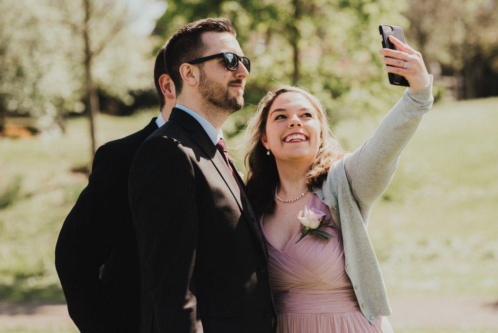 wedding guests taking a selfie