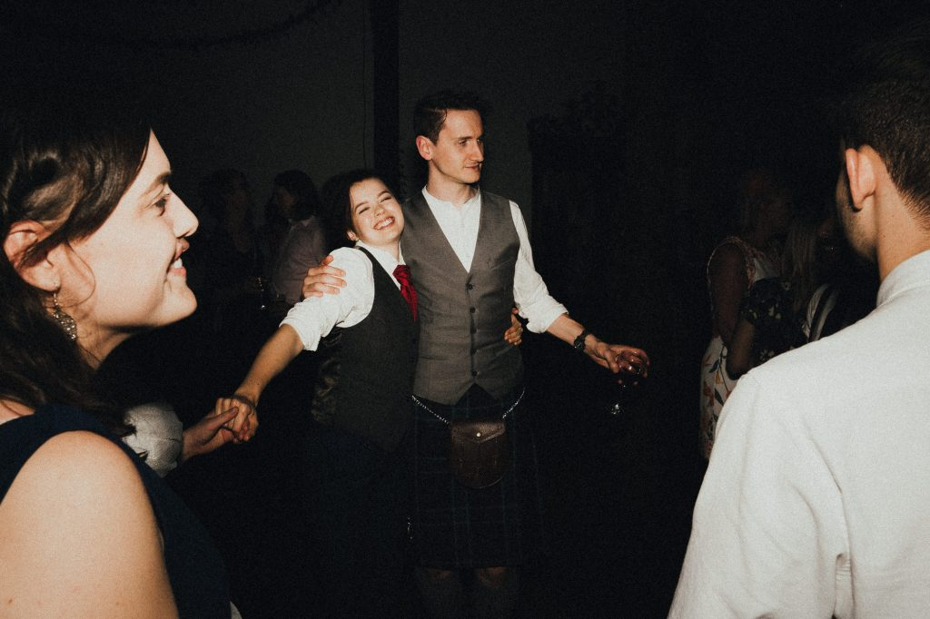 bride dancing with a guest