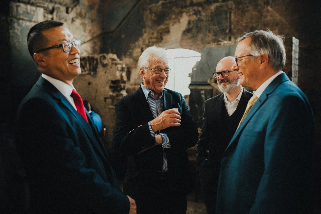 guests laughing at a joke during reception