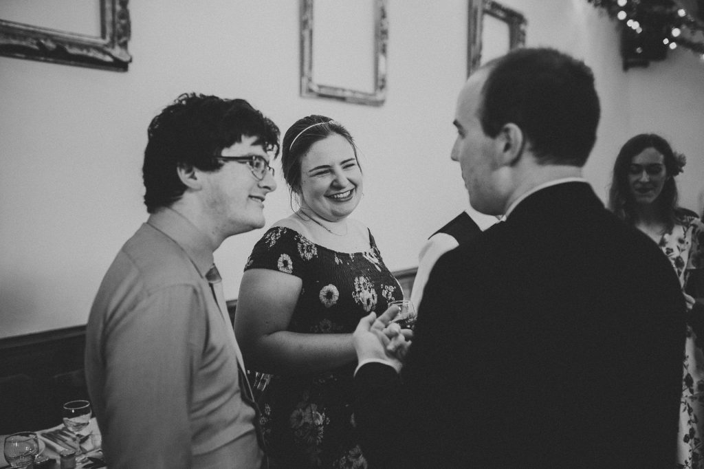 guests telling stories at reception