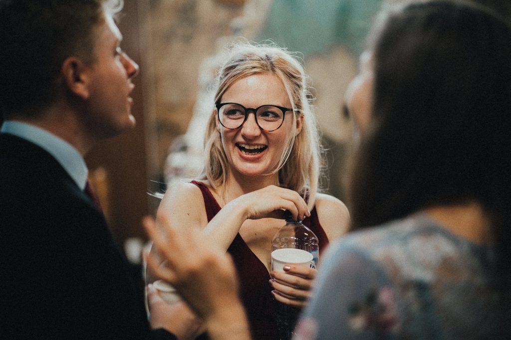 bridesmaid laughing at a joke