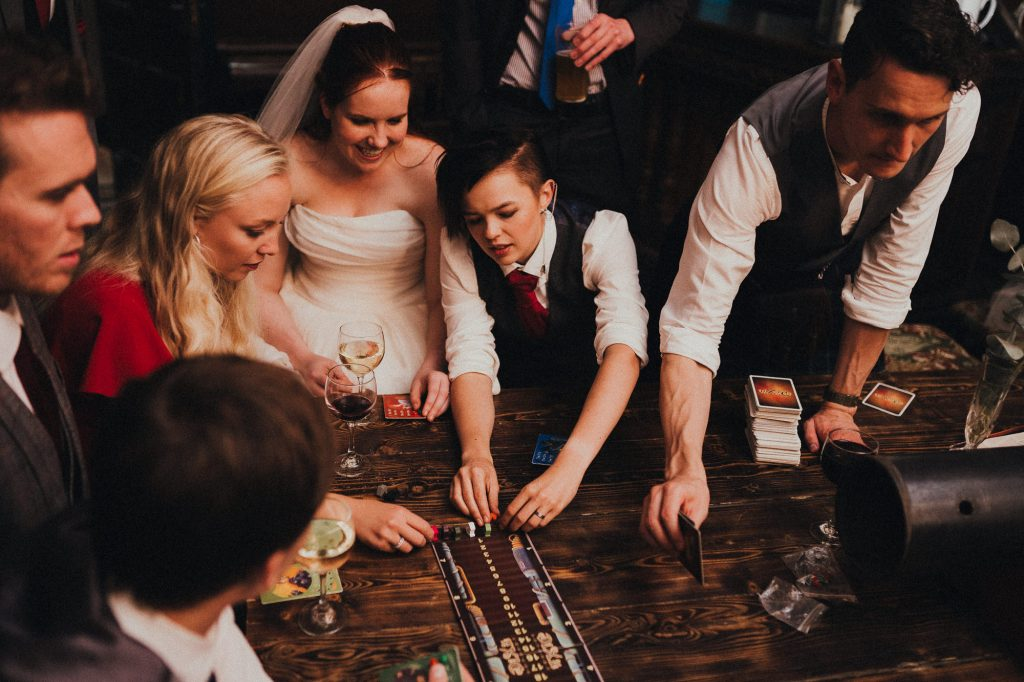 couple playing board games at reception