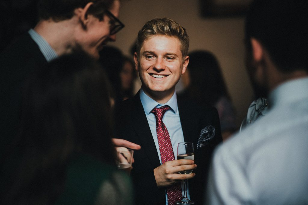 guest smiling at a joke