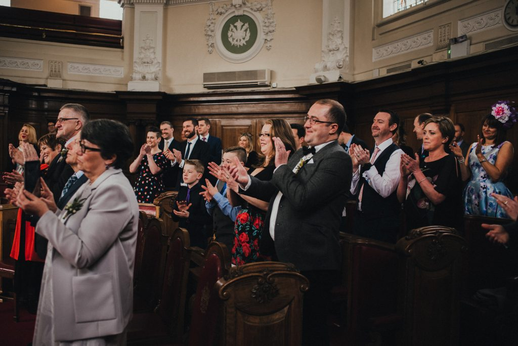 guests applaud during wedding ceremony
