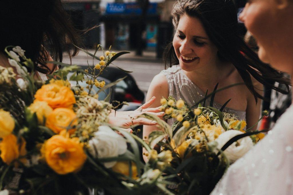 bride shows bridesmaid her ring