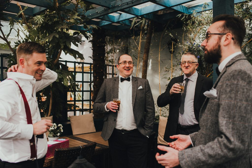 groom's brother laughing