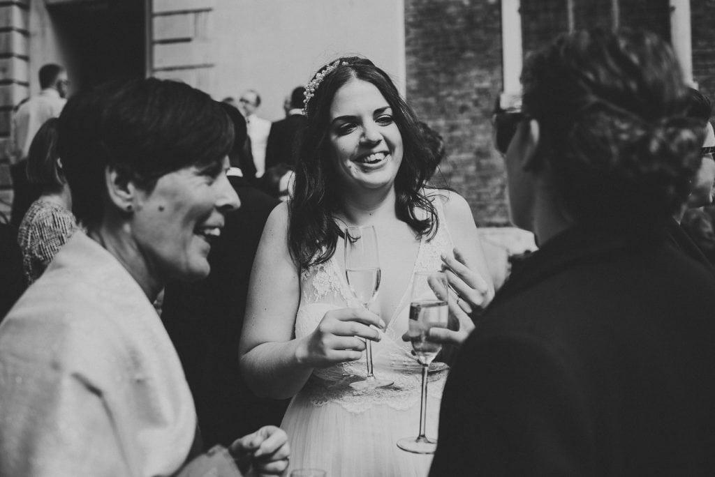 bride laughs during reception