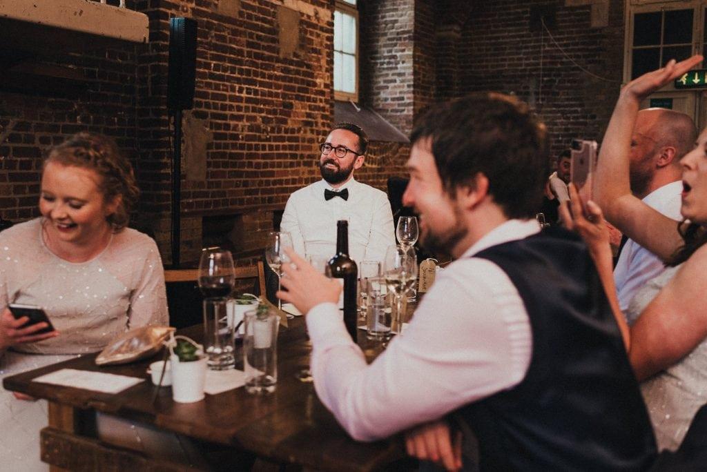 groom reacts to bride's speech