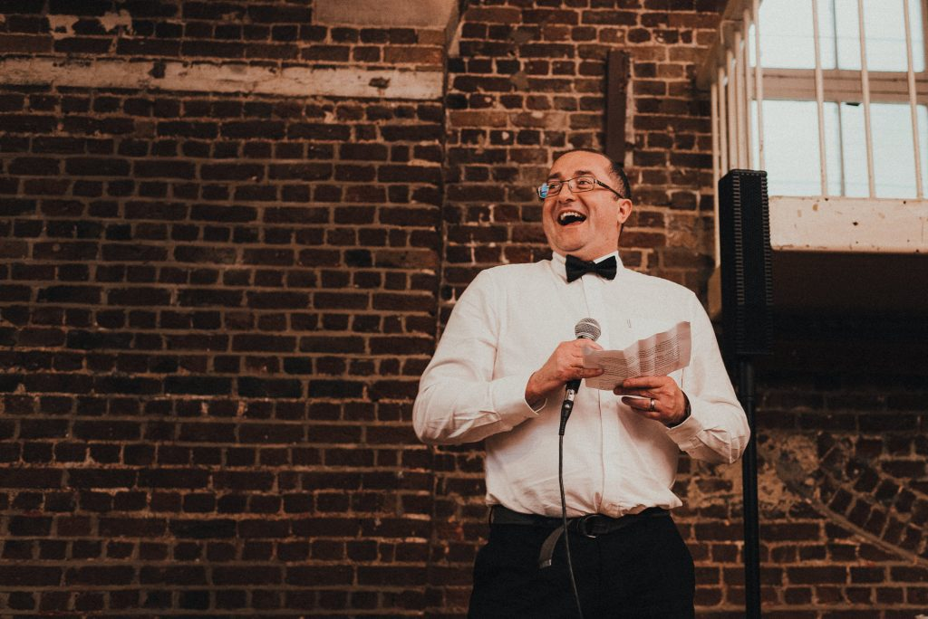 best man laughing during speech