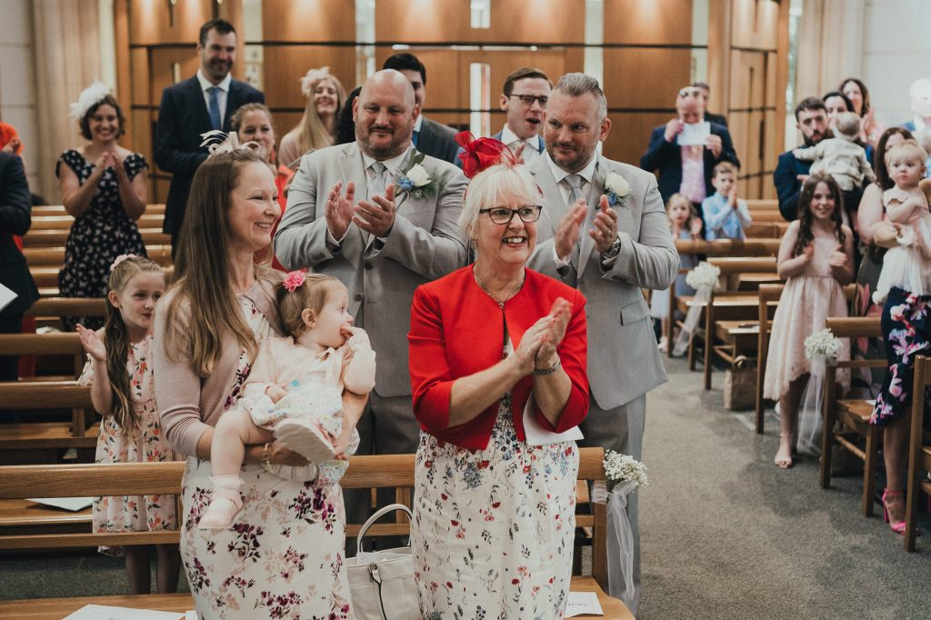 the guests applauding the couple getting married