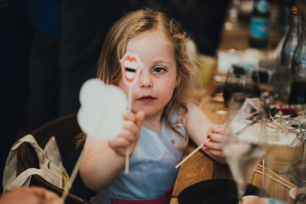 a girl playing with party favours