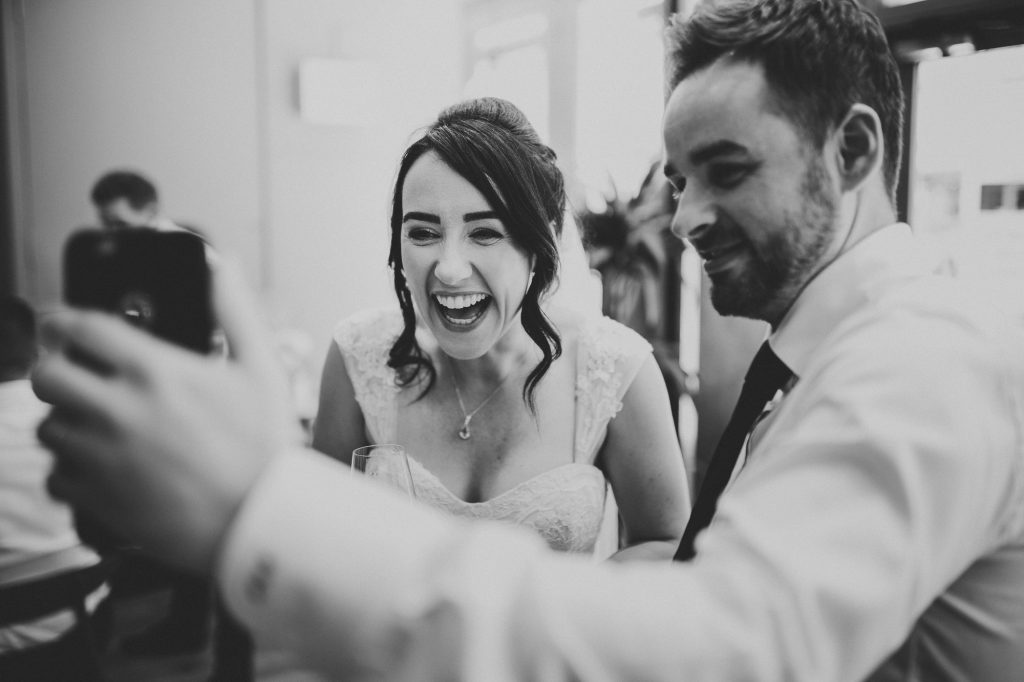 the bride laughing at a funny video