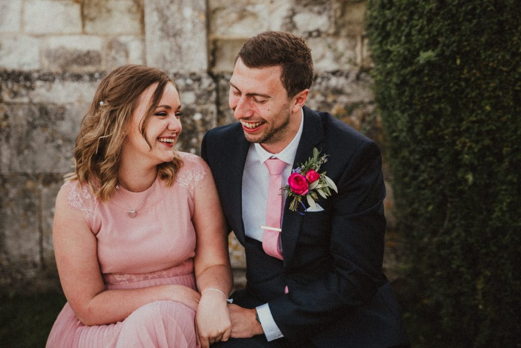 bridesmaid laughing with her boyfriend
