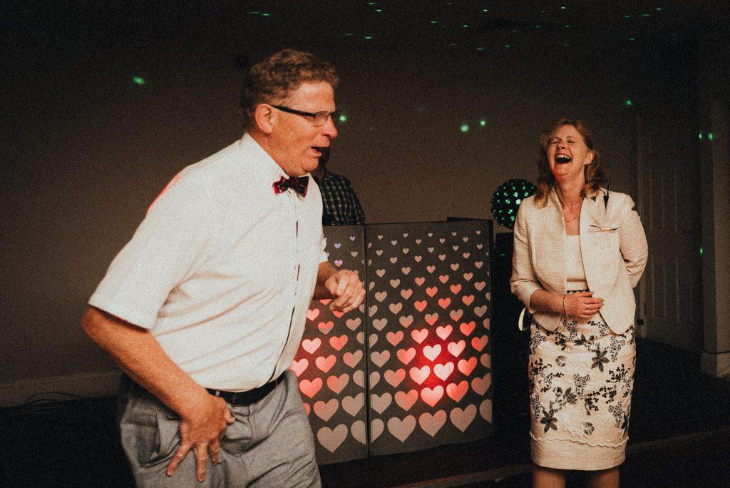 wedding guests doing goofy dances