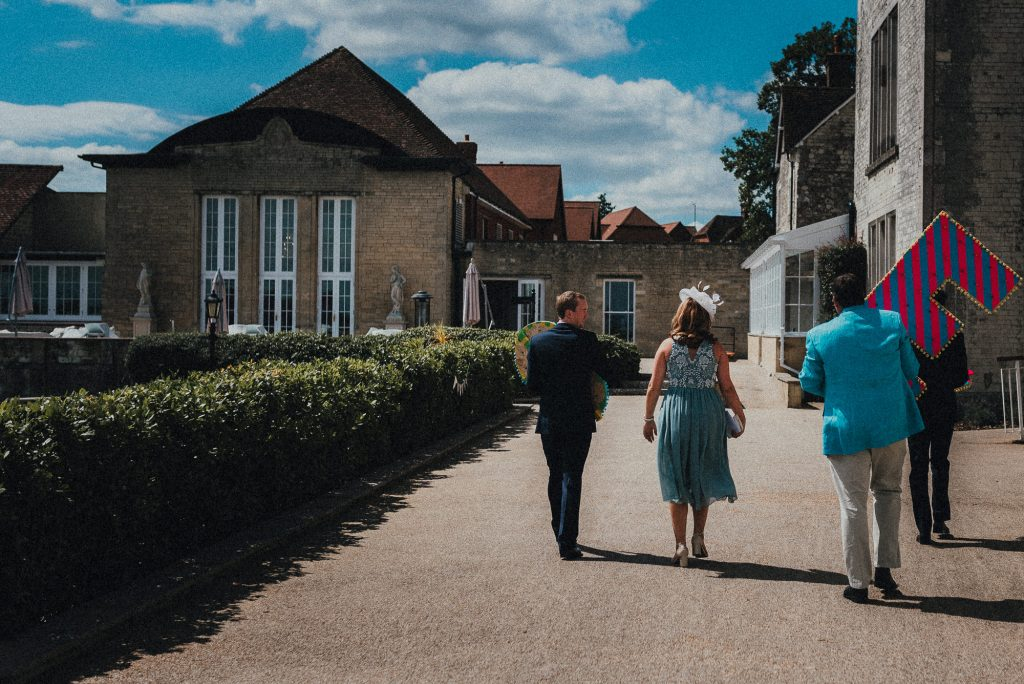 wedding guests taking giant letters into venue