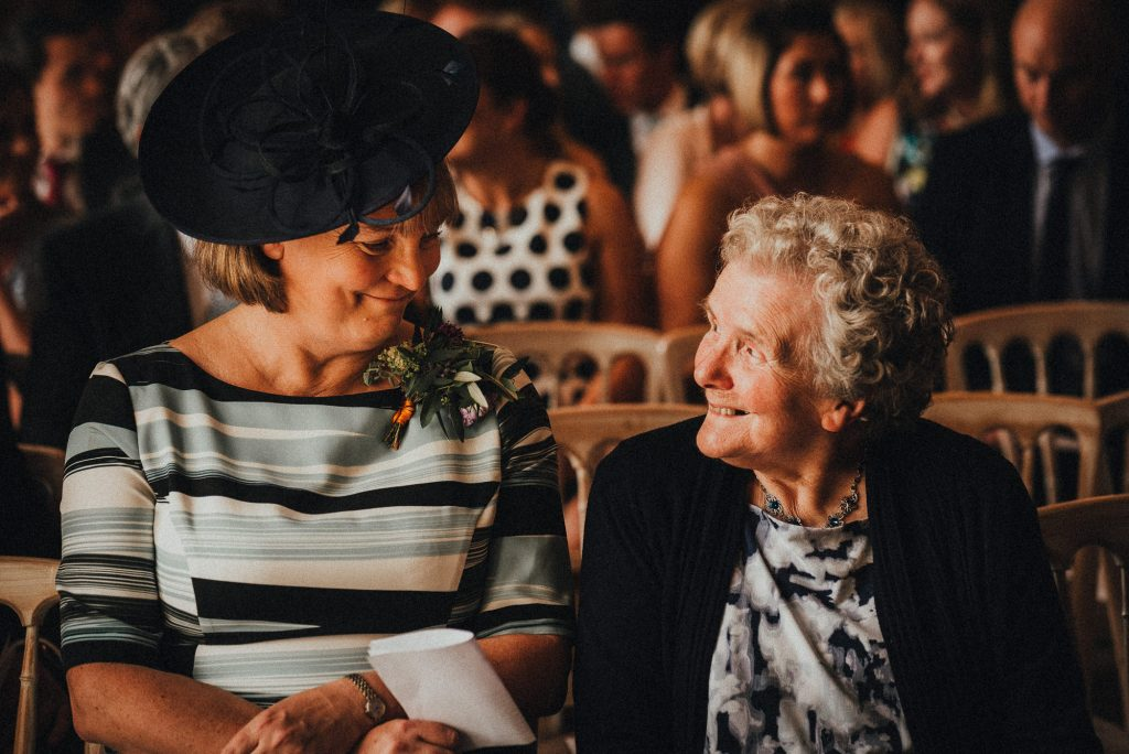 mother of the groom smiling at her mum
