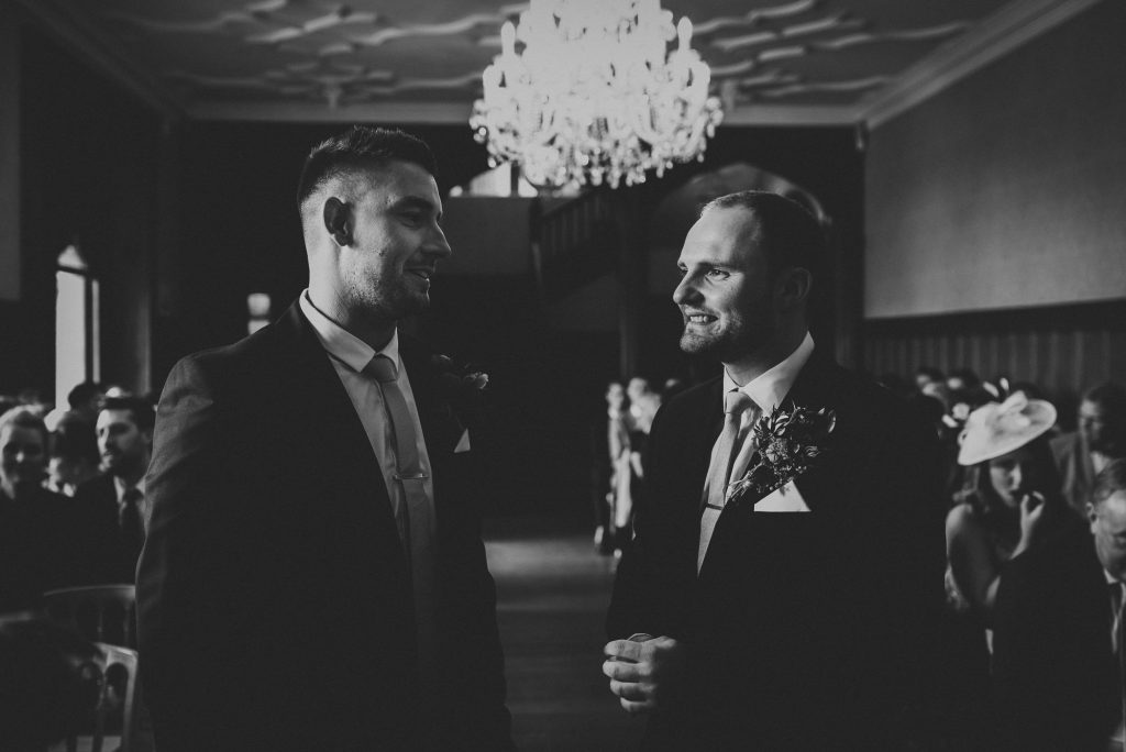 groom and best man waiting at top of aisle