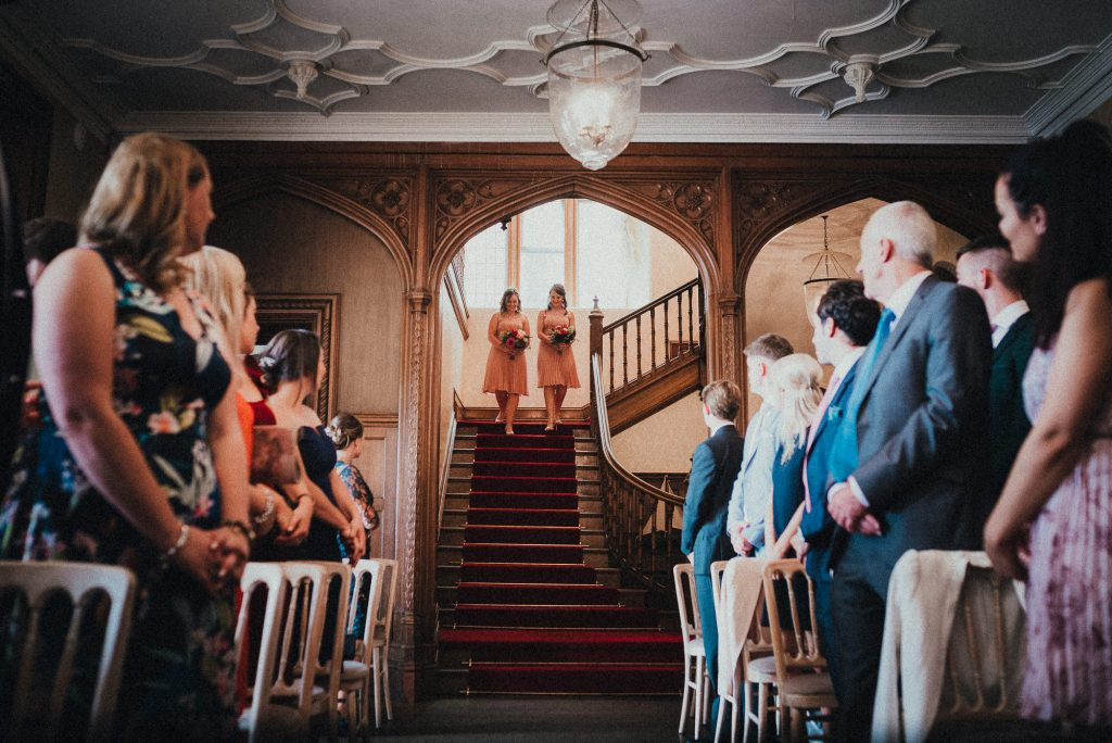 bridesmaids walking down the stairs