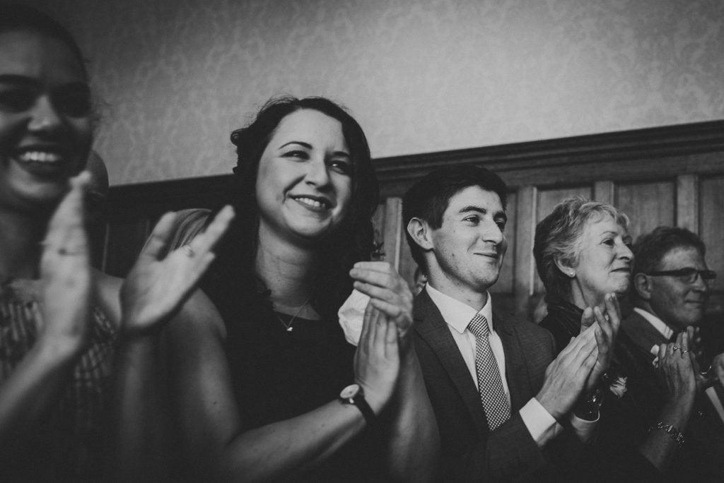 wedding guests applauding